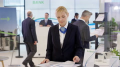 4K Portrait of friendly smiling financial adviser at customer help desk in bank Stock Footage