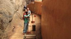 People visit Mirror wall at the Sigiriya rock in Sigiriya, Sri Lanka. Stock Footage