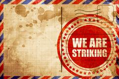 we are striking, red grunge stamp on an airmail background - stock illustration