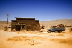 old farmhouse and truck in the desert of California - stock photo