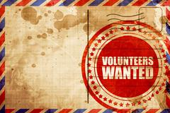 Volunteers wanted, red grunge stamp on an airmail background Piirros