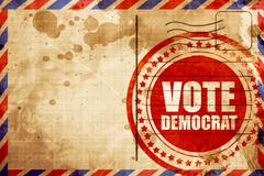 vote democrat, red grunge stamp on an airmail background - stock illustration