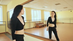 Beautiful sexy girl vigorously dances in front of a mirror Stock Footage