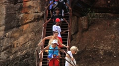 People descend by the stairs of the ancient Sigiria rock fortress, Sri Lanka. Stock Footage
