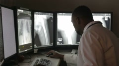 Radiologist Reading X-rays In Hospital - stock footage