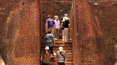 People climb and descend by the stairs in Sigiria rock fortress, Sri Lanka. Stock Footage
