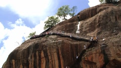 People descend by the stairs from the Sigiriya rock fortress, Sri Lanka. Stock Footage