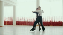 Beautiful couple of professional artists dancing passionate dance Stock Footage