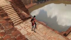 People visit ruins of the ancient Sigiriya rock fortress, Sri Lanka. Stock Footage