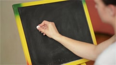 Student writing on large blackboard in school, back to school, first september Stock Footage