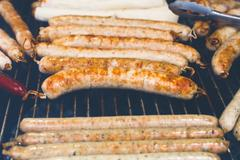 Street fast food, grilled sausages at bbq - stock photo