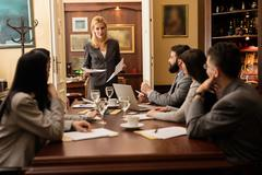 Group of young business people or lawyers - meeting in an office Stock Photos