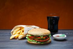 Fast food take away. Hamburger, cola and fries Stock Photos