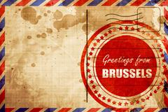 Greetings from brussels, red grunge stamp on an airmail backgrou - stock illustration
