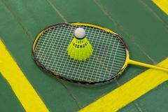 Badminton racket and shuttlecock - stock photo