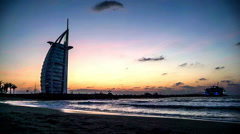 Timelapse of the twilight at the Burj Al Arab and the Jumeirah beach in Dubai Stock Footage