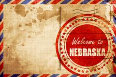 Welcome to nebraska, red grunge stamp on an airmail background - stock illustration
