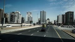 Fast forward of the modern cityscape view by bus in Dubai, UAE Stock Footage