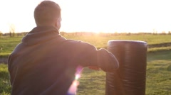 Boxer punching back rear view sunset Stock Footage