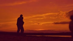 Silhouettes of people hugging slow motion video - stock footage