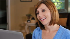 Woman patient using telemedicine to describe symptoms to doctor - stock footage