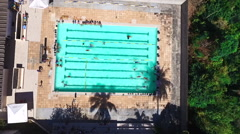 Kids Swimming in the Pool, Zoom Out, Aerial Stock Footage