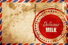 Delicious milk sign - stock illustration