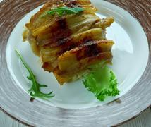 Baked cod wrapped in bacon - stock photo