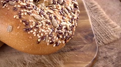 Wholemeal Bagels (seamless loopable; 4K) Stock Footage