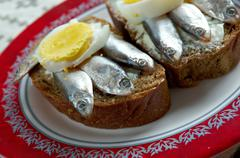 Estonian sandwich with  anchovies Stock Photos