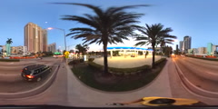 360 spherical video Sunny Isles at dusk street pov Stock Footage