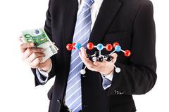 Holding a tnt molecule and money Stock Photos