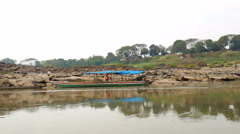 Sides of the Mekong from long-tailed boat (Hands shot) Stock Footage
