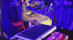 African man play bongo drums on open air night party. Dreadlocks. Blue - stock footage