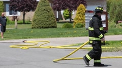 Fireman moving firehose Stock Footage