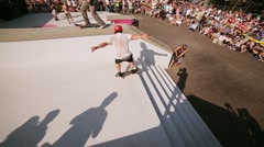 Skaters jump from stairs, make flips, get spill at summer festival. Audience Stock Footage