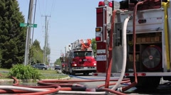 firetruck with water hoses in foreground - stock footage