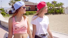 Beautiful and confident female friends near beach Stock Footage