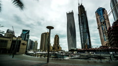 Timelapse of the visitors wander at Dubai Marina(Cayan Tower), UAE Stock Footage