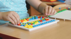 Child plays the intellectual educational game - stock footage