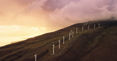 Aerial view of windmills turning at sunset - stock footage