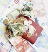 Travel on vacation lifestyle concept: cash money on table in mess with passport Kuvituskuvat