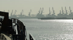 Industrial port with crane machine and factory pollution by day Stock Footage