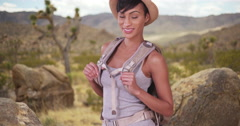 Happy smiling black woman backpacking in desert Stock Footage