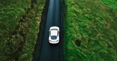 Aerial view electric car driving on country road Arkistovideo