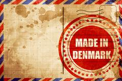 Made in denmark, red grunge stamp on an airmail background Stock Illustration