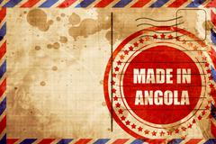 Made in angola, red grunge stamp on an airmail background - stock illustration