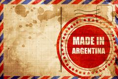 Made in argentina, red grunge stamp on an airmail background Stock Illustration