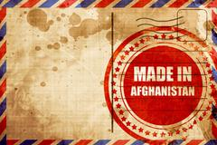 Made in afghanistan, red grunge stamp on an airmail background Stock Illustration