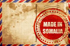 Made in somalia, red grunge stamp on an airmail background Stock Illustration
